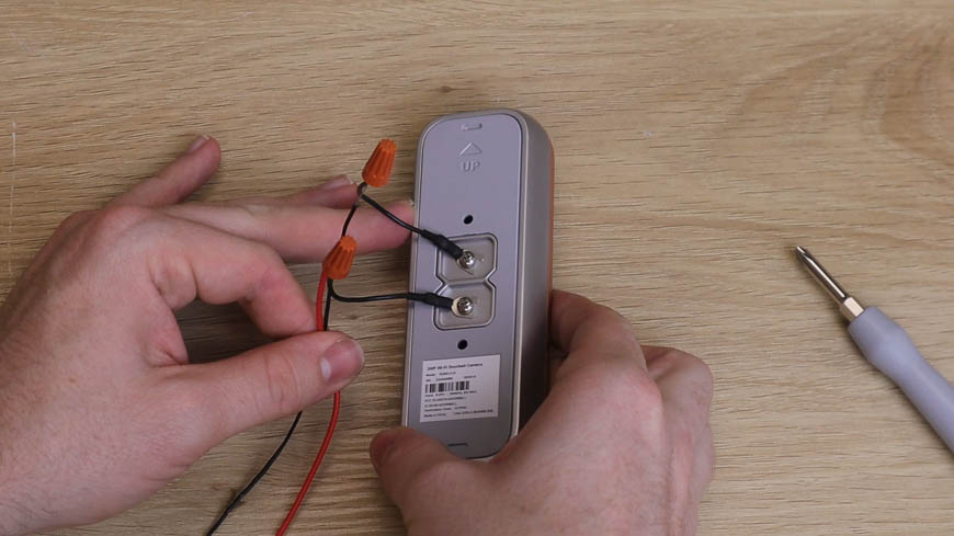 Attach the U-Shaped wires to the back of your doorbell.
